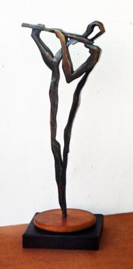 Изработка на дърворезба на пластика Флейтист