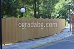 плътна висока дървена ограда по поръчка